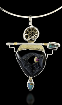 Photo of pendant with gold, silver and semi-precious stones.